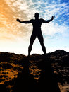 Freedom silhouette of man and sunshine on sky background Stock Image