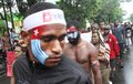 Freedom of west papua dozen papuan student takes part on a rally in solo central java indonesia december they are demanding the Stock Photography