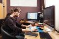 Freelance developer and designer working at home man using desktop computer Stock Photography