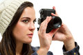 Freelance female photographer taking pictures with an old camera Royalty Free Stock Image