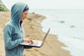 Freelance working on beach freelancer young woman laptop shore near the sea concept Royalty Free Stock Photography