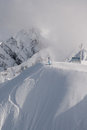 Freerider preparing to descend from the summit ridge aibka sochi russia Royalty Free Stock Images