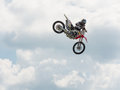 Freestyle jumper a rider doing a dangerous stunt at the triumph superbike races in birmingham alabama at barber motorsports park Royalty Free Stock Photography