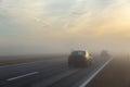 Freeway and a car in fog