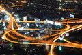 Freeway in night with cars light in modern city for design Royalty Free Stock Photo