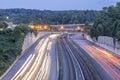 Freeway with train tracks Royalty Free Stock Photo