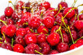 Freezed drops over the ripe cherry rinsed with water of cherries in white colander Royalty Free Stock Images