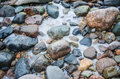 The freezed stones on coast of baltic sea a winter landscape Royalty Free Stock Photos