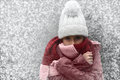 Freezing girl with bobble hat and scarf outside in snow Stock Photography