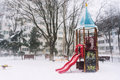 Freezing playground castle with slide in a heavy winter snowfall Royalty Free Stock Images