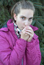 Freezing teenager girl young pretty in cold weather outdoors Royalty Free Stock Photography