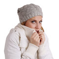 Freezing woman young wearing woolen hat and winter jacket is Stock Photo