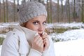 Freezing woman young wearing woolen hat and winter jacket is Royalty Free Stock Images