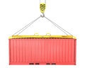 Freight container hoisted on container spreader Stock Photography