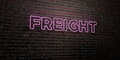FREIGHT -Realistic Neon Sign on Brick Wall background - 3D rendered royalty free stock image Royalty Free Stock Photo