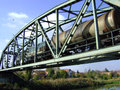 Freight train on the bridge transition locomotives and over a metal Royalty Free Stock Photo