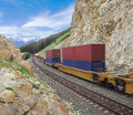 Freight train in canadian rockies Stock Photos