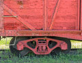 Freight train closeup of a box car and it s wheels Royalty Free Stock Photo