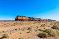 Freight Train driving through Mojave Desert California Royalty Free Stock Photo