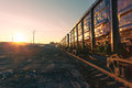 Freight train goods wagons at sunrise Royalty Free Stock Image
