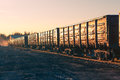 Freight train goods wagons at sunset Stock Images