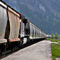 Freight train long in canadian rockies Stock Images