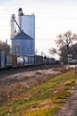 Freight train moves slowly through a rural town Royalty Free Stock Photo