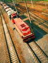 Freight train moving on railroad Stock Photos
