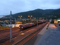 Freight train from north sweden with ironstone approach to non freezing narvik sea port at early morning on july in narvik norway Stock Photography