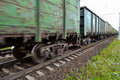 Freight train, railway wagons with motion blur effect. Transportation, railroad. Royalty Free Stock Photo