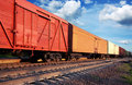 Freight train under sky clouds Royalty Free Stock Photo