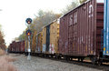 Freight train yellow lights a passes a track signal light Royalty Free Stock Photos