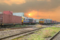 Freight trains on cargo terminal at dusk Royalty Free Stock Photo