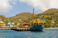 A freighter alongside a wharf in the windward islands Royalty Free Stock Photo