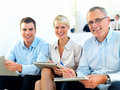 Freindly modern business people sitting together Royalty Free Stock Images