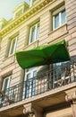 French balcony with sun protection umbrella Royalty Free Stock Photo