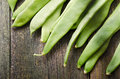 French beans close up of green on a wooden table Royalty Free Stock Images