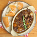 French beef bourguignon stew served with crusty bread Royalty Free Stock Photography