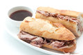 French beef dip sandwich au jus a or on a baguette with dipping sauce or Stock Images