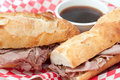 French beef dip sandwich au jus a or on a baguette with dipping sauce or Stock Photography