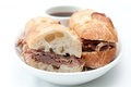 French beef dip sandwich au jus a or on a baguette with dipping sauce or Royalty Free Stock Photography