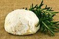 French cheese a closeup of gaperon and rosemary ona burlap background Royalty Free Stock Photography