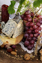 French cheese, fruits and objects isolated Stock Photography