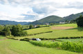 French country landscape pyrenees atlantiques there are green fields pastures and farms against the background of the foothills of Royalty Free Stock Image