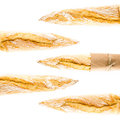 French crusty baguette of whole wheat bread on a white backgrou golden background closeup Royalty Free Stock Image