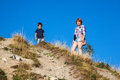 French family trekking in haute savoie mother and son standing on top of hill Stock Image
