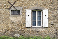 French farmhouse window stone with white shutters and hearts Stock Photography
