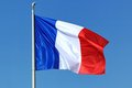 French flag blue white and red floating in the wind in a deep blue sky background Stock Image