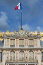 French flag in top of Palace Versailles near Paris Royalty Free Stock Photo
