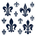 French fleur de lis heraldic symbols and flowers royal dark blue with ornamental compositions of victorian leaf scrolls curly Royalty Free Stock Photography